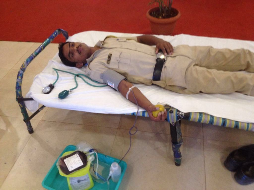 A POLICEMAN DONATING BLOOD